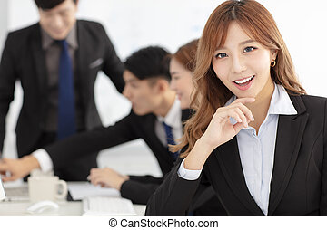 smiling business woman  with colleagues on background