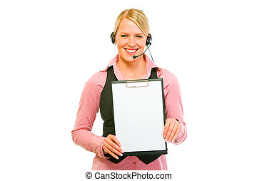 Smiling business woman with headset showing blank clipboard
