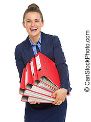 Smiling business woman with stack of folders