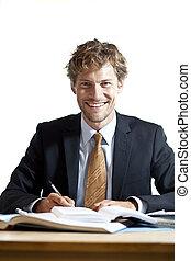 Smiling businessman at work