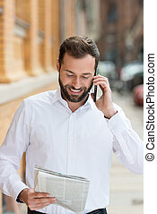 Smiling businessman chatting on his mobile