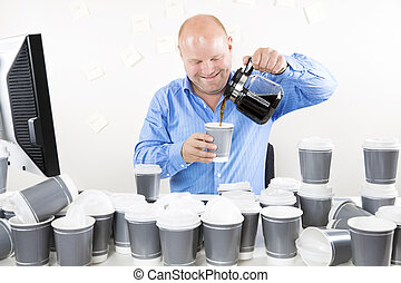 Smiling businessman drinks too much coffee