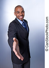 Smiling businessman giving hand