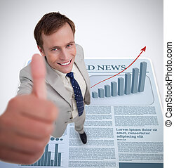 Smiling businessman giving thumb up