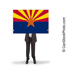 Smiling businessman holding a big card, flag of Arizona