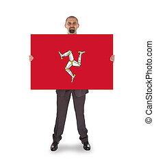 Smiling businessman holding a big card, flag of Isle of Man