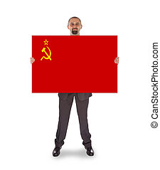 Smiling businessman holding a big card, flag of the USSR