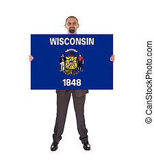 Smiling businessman holding a big card, flag of Wisconsin