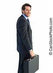 Smiling businessman holding a briefcase