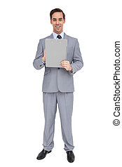 Smiling businessman holding a clipboard