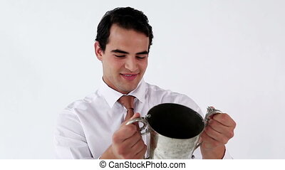 Smiling businessman holding a cup