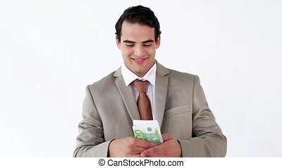 Smiling businessman holding a fan of notes