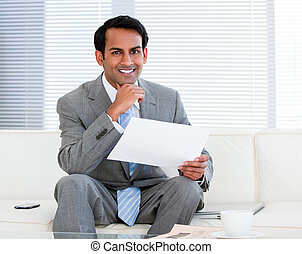 Smiling businessman holding a note