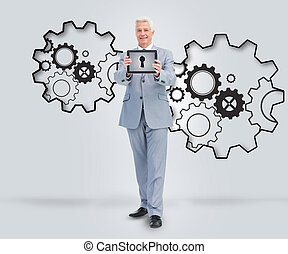 Smiling businessman holding a table