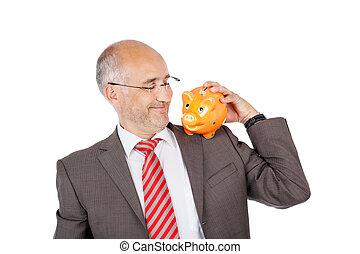 smiling businessman holding piggy on his shoulder