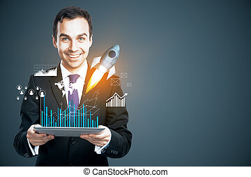 Entrepreneurship concept - Smiling businessman holding ...