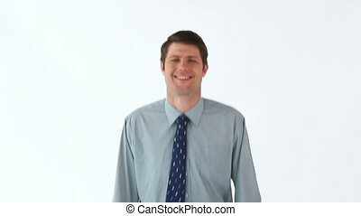 Smiling businessman hopping against a white background