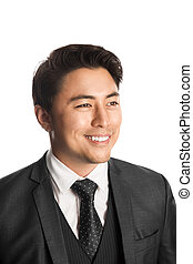 Smiling businessman in a gray suit