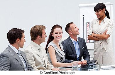 Smiling businessman in a presentation