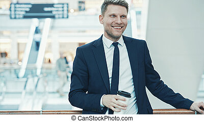 Smiling businessman in a store
