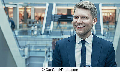 Smiling businessman in a suit