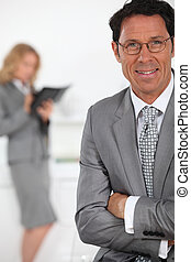 smiling businessman in foreground