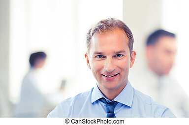 smiling businessman in office