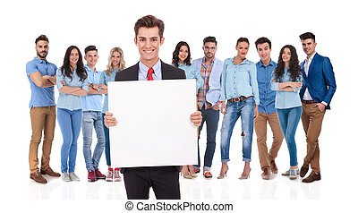 smiling businessman leader holding a blank board in front