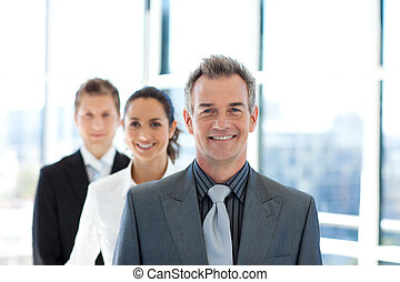 Smiling businessman leading a business team