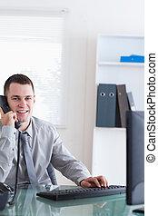 Smiling businessman listening to caller