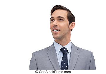 Smiling businessman looking away against white background
