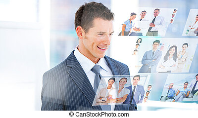 Smiling businessman looking picture