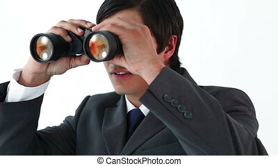 Smiling businessman looking through binoculars