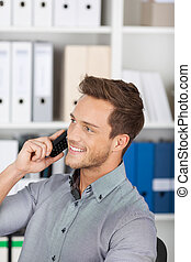 Smiling Businessman On Call