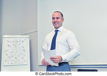 smiling businessman on presentation in office