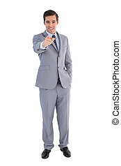 Smiling businessman pointing at the camera