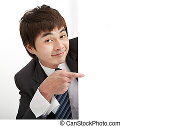 smiling businessman pointing blank board