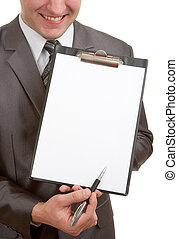 Smiling businessman pointing clipboard
