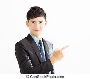 smiling Businessman pointing copy space
