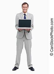 Smiling businessman presenting screen of his laptop