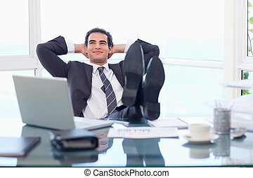 Smiling businessman relaxing