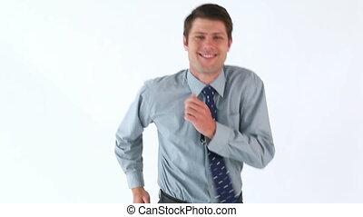Smiling businessman running