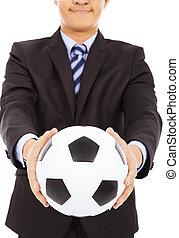 smiling businessman show a soccer