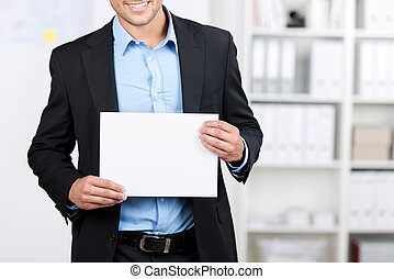 Smiling businessman showing a blank sheet