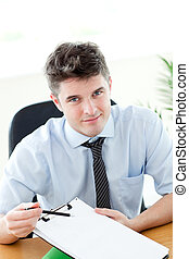 Smiling businessman showing a contract to a customer in the...
