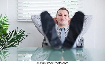 Smiling businessman sitting back