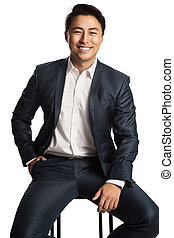 Smiling businessman sitting down