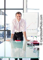 Smiling businessman standing in a presentation
