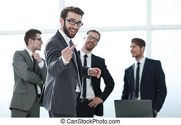 smiling businessman standing in the office