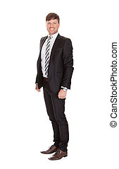 Smiling Businessman Standing Over White Background